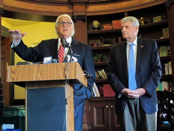 Maryland Senate President Mike Miller (left) and House Speaker Michael Busch discuss an FBI briefing they received about Russian links to a company that maintains part of the state's voter registration platform during a news conference in Annapolis, Md.