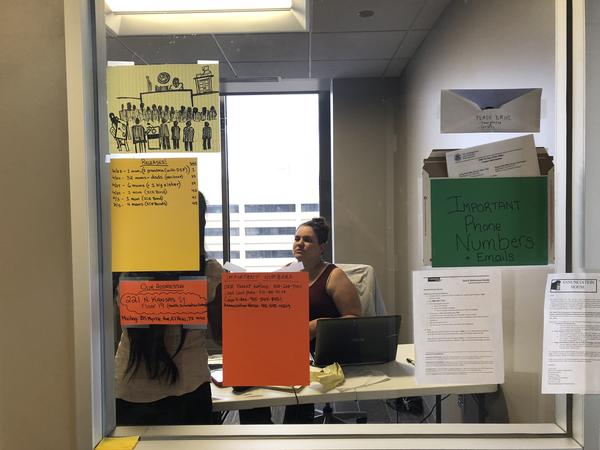 Taylor Levy in her office; she is the legal coordinator for Annunciation House, a migrant shelter in El Paso, Texas.