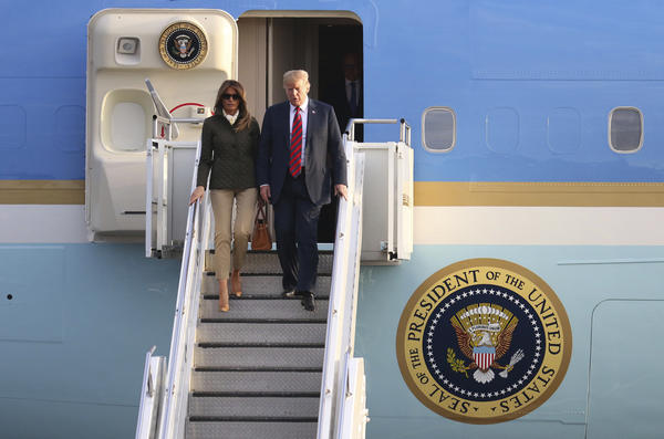 U.S. President Donald Trump and first lady Melania Trump disembark from Air Force One as they arrived in  Scotland on Friday.
