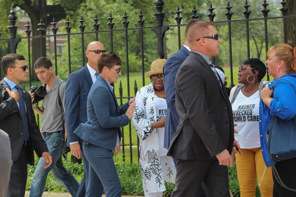 Protestors from SEIU were led out by members of the governor's security detail. The union members had begun chanting during the dedication ceremony.