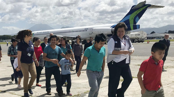 Families separated under President Donald Trump administration's zero tolerance policy return home to Guatemala City Tuesday, July 10, 2018, after being deported from the United States.