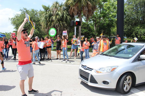 Protesters blocked the intersection of Southwest 145th Avenue and Southwest near the U.S. Immigration and Customs Enforcement field office in Miramar on Wednesday, July 18, 2018.