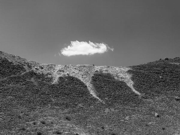 A cloud on the top of a hill near the phosphate field, Al-Mitlawi