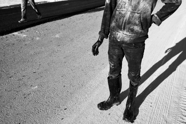 An asphalt worker during road building, Gafsa