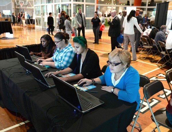 People looking to get a job at MGM Springfield use the computer to match their skills to potential jobs, during a career fair in October 2014.