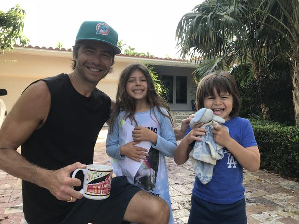Tadd Schwartz with his daughter Siena, 6, and son Sevi, 3, in front of their Coconut Grove home. Schwartz says risk from storm surge and climate change has changed his thinking about how long he wants to hold onto the house.