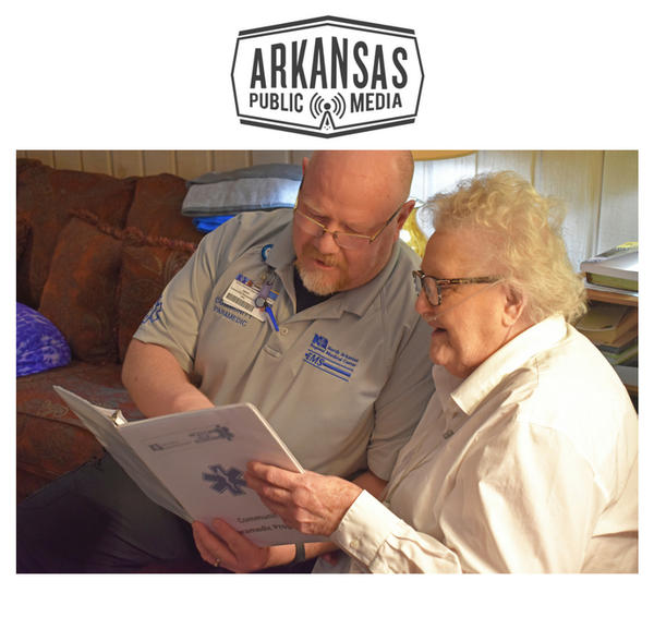 Jason Moshier, North Arkansas Regional Medical Center Community Paramedics section chief, visits with Julie Younes, an 87-year old  Community Paramedic program patient.