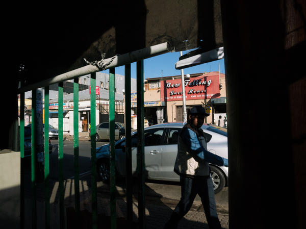 A man walks in front of a restaurant owned by a Zimbabwean expat in Johannesburg. The largest Zimbabwean diaspora community is in South Africa.