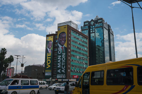 Emmerson Mnangagwa's campaign poster hangs on the side of a building in downtown Harare.