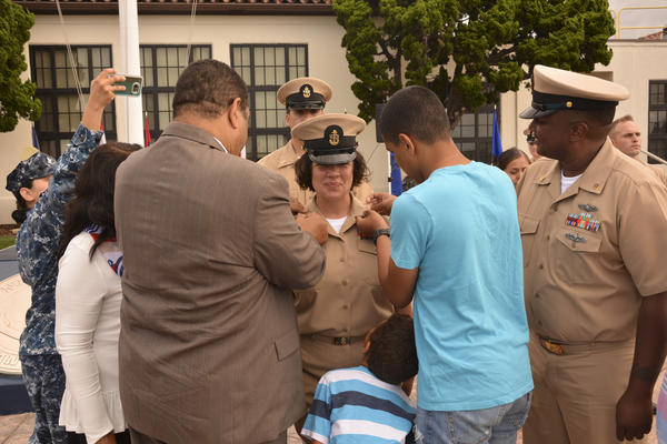 Angelina Gabriel's family surrounds her as she's promoted to the rank of Navy Chief Petty Officer in a September ceremony. Gabriel's husband also is a Chief Petty Officer in the Navy.
