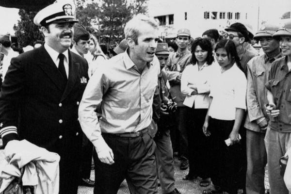 John McCain is escorted to Hanoi's Gia Lam Airport in 1973 upon his release after 5 1/2 years' imprisonment as a POW.