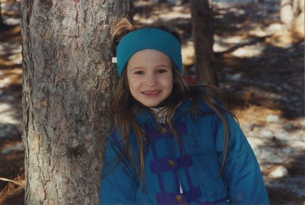 A childhood photo of Adrianne Lenker, lead singer, guitarist and songwriter in Big Thief.