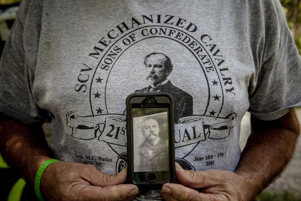 At the Forrest celebration, Gary Elam holds a photograph of his great-great-grandfather, Maj. Oliver Buckley Farris, who fought in the Confederate army.