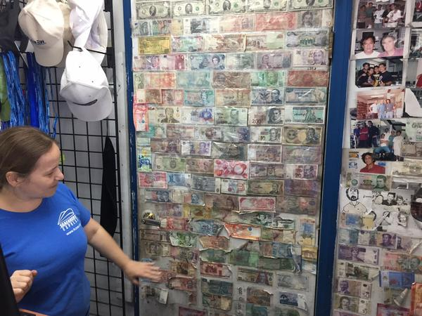 Foreign currency adorns the wall at the Seafarers House electronics market.