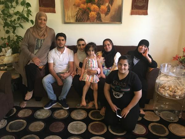 Alwaleed Abdullah and Fatimah Abbood, center with Abbood's family in Boise.