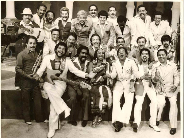 Singers and musicians from Fania Records including Celia Cruz (bottom, center), Ruben Blades (directly above Celia Cruz) and label co-originator, Johnny Pacheco (top row, fifth from left).