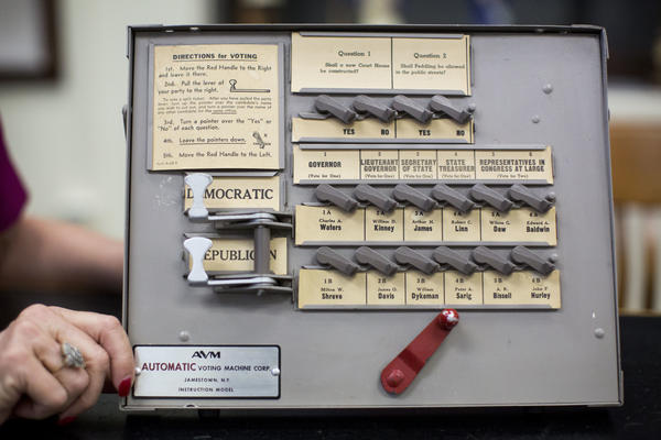 Old-fashioned manual machines such as these were banned after the 2000 presidential election. Now, states are starting to move away from the touchscreen electronic voting machines that don't produce a paper trail that were introduced after that election.