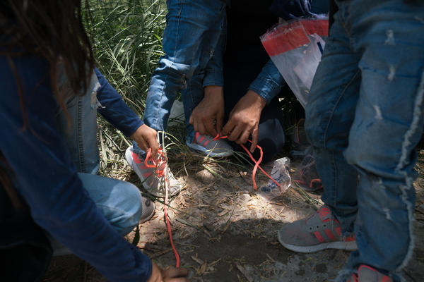 Asylum-seekers are asked to take off their shoelaces.