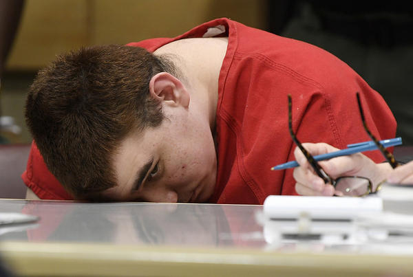 Nikolas Cruz, who gunned down 17 people at Marjory Stoneman Douglas High School in Parkland, Florida, briefly looks up during a hearing where attornies are debating several issues on Monday, July 16, 2018 in Fort Lauderdale.