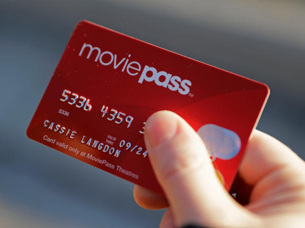 Cassie Langdon holds her MoviePass card outside AMC Indianapolis 17 theatre in Indianapolis on Jan. 30. MoviePass, the discount service for movie tickets, announced it will not be raising prices but will be capping theater visits at three per month.