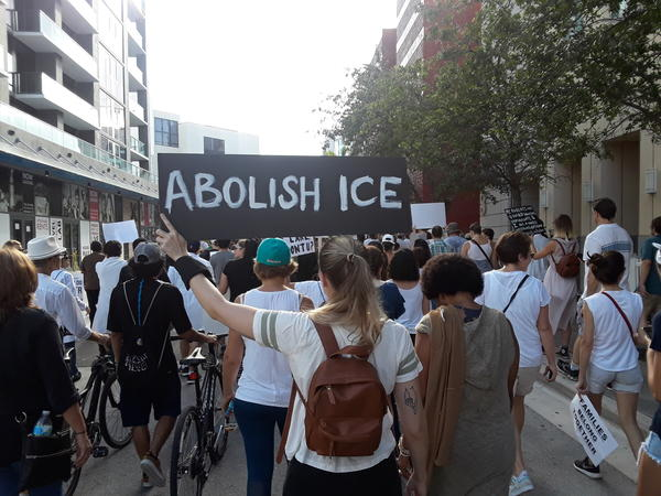 Protestors rally against ICE in Miami.