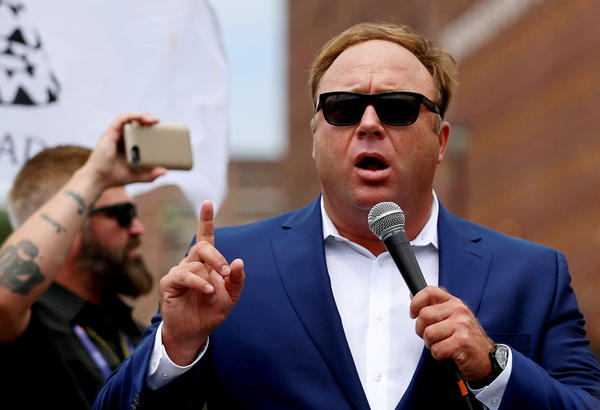 "Alex Jones, shown here at a July 2016 rally in support of then-candidate Donald Trump, says he is being subjected to a ""purge"" from big tech companies."