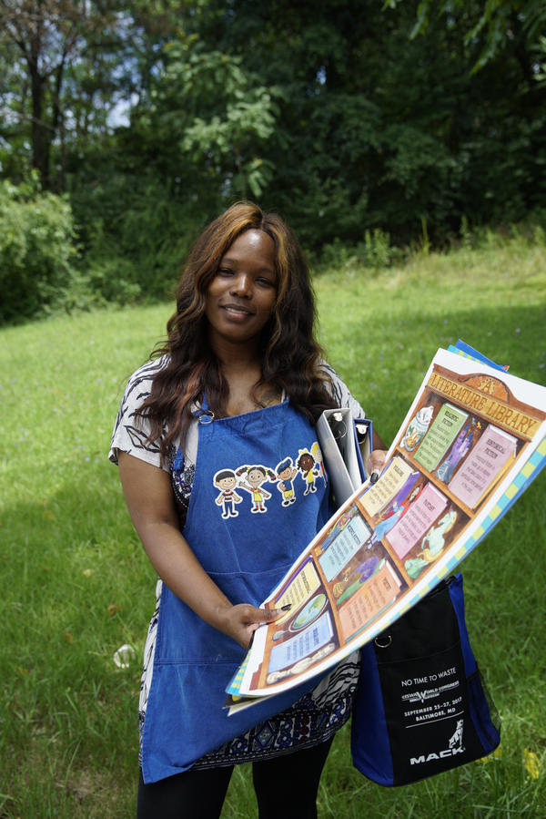 Lauretta Pugh holds posters she found at the Swap.