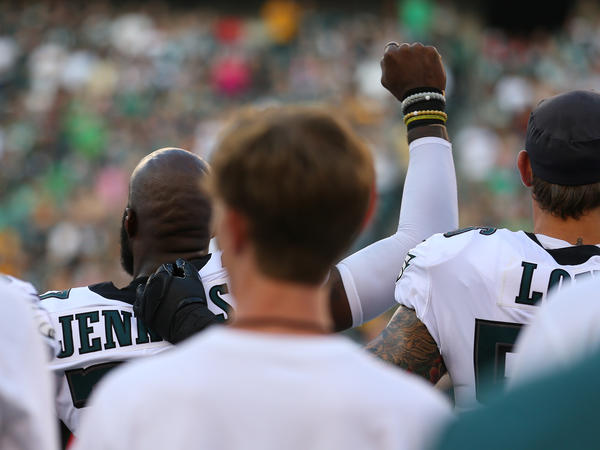 Malcolm Jenkins of the Philadelphia Eagles raises his fist during the national anthem as Chris Long puts his arm around him before the preseason game against the Pittsburgh Steelers at Lincoln Financial Field on Thursday in Philadelphia.