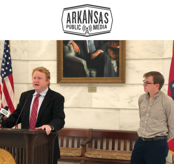 Lawyer Chris Burks speaks at a press conference today along with Reed Brewer, spokesman for the Democratic Party of Arkansas.