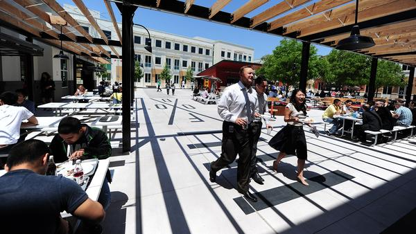 People walk into the cafeteria at Facebook's main campus in Menlo Park, Calif., May 15, 2012.