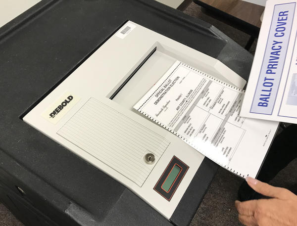 Voters in McLean County have the option to use electronic machines, which have a secure paper trail, or cast their vote the old fashioned way with a paper ballot.
