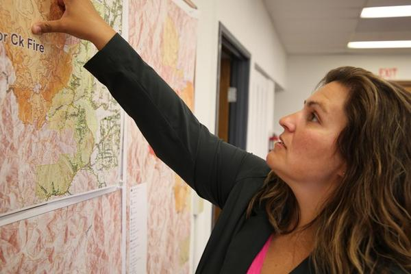 <p>Josephine County Commissioner Lily Morgan points out containment lines on a wildfire threatening homes.&nbsp;</p>
