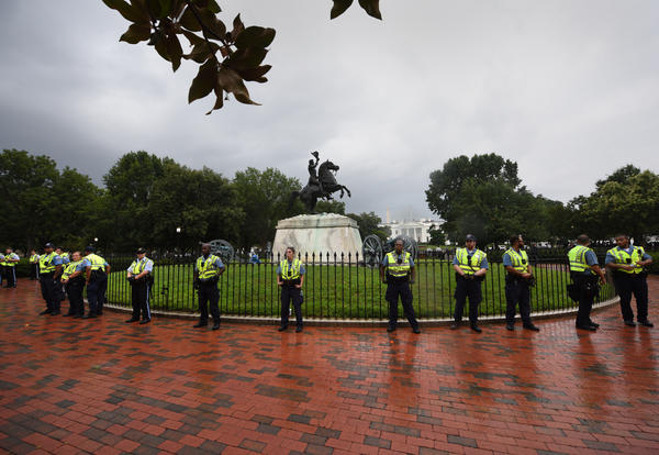 Security officials stand guard as right wing extremists stage a demonstration.