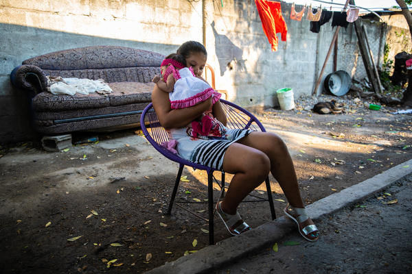 Cindi and her baby girl in San Pedro Sula. Her boyfriend Moises left the neighborhood a few months after she became pregnant. Cindi sent photos of the baby to Moises via WhatsApp. But a few weeks ago, he stopped responding to her texts, which worries Cindi. She hopes that Moises is OK and that she will hear from him again soon.