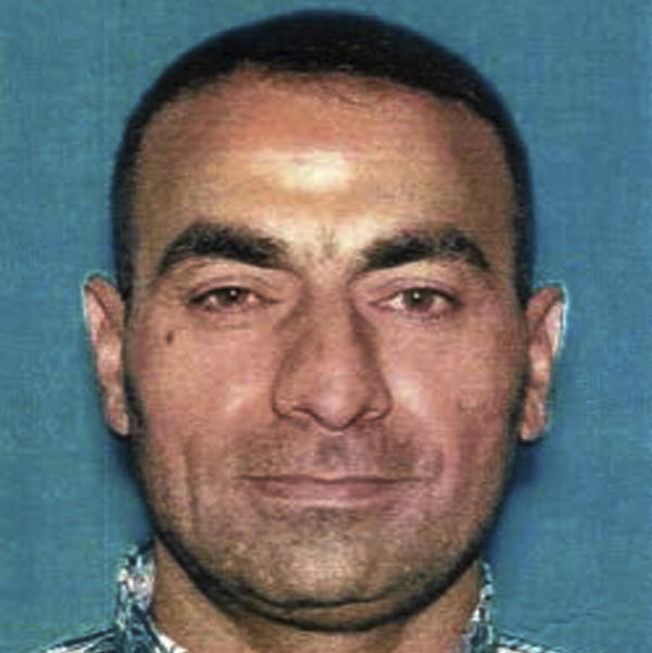 This undated photo provided by the U.S. Attorney's Office shows Omar Ameen, who had been living in California as a refugee and was arrested Wednesday on a warrant alleging he killed an Iraqi policeman while fighting for the Islamic State.