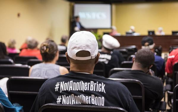 Supporters of the Action4Ashley campaign wore shirts with bold hashtags at a meeting of the Winston-Salem/Forsyth County school board.