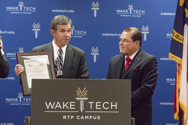 Wake Tech President Stephen Scott with Governor Roy Cooper as he received the Order of the Long Leaf Pine award, the highest honor for a private citizen in North Carolina.