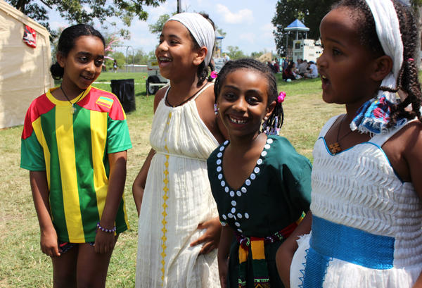 A few girls practice a traditional Ethiopian dance before they perform Saturday at Kansas City's annual Ethnic Enrichment Festival in Swope Park.