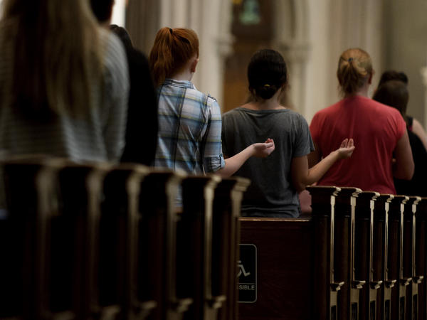 Parishioners worship during Mass at St. Paul Cathedral, the mother church of the Pittsburgh Diocese, last week.