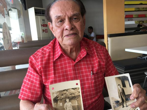 Maximo Purisima Young, 97, displays photographs from his military service. He helped transport supplies and troops in World War II, then fought as a guerilla alongside American soldiers.