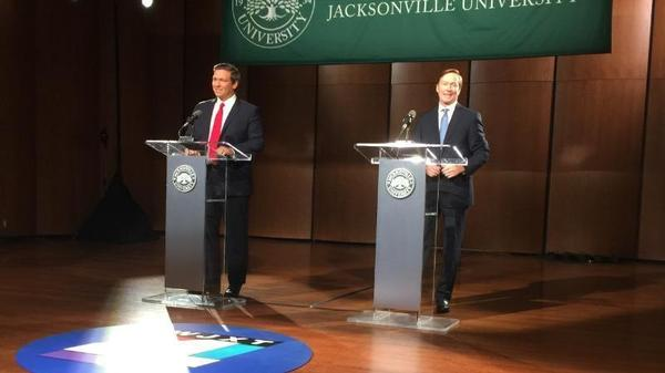 Ron DeSantis (left) and Adam Putnam shared the stage on Aug. 8 at Jacksonville University for a debate.
