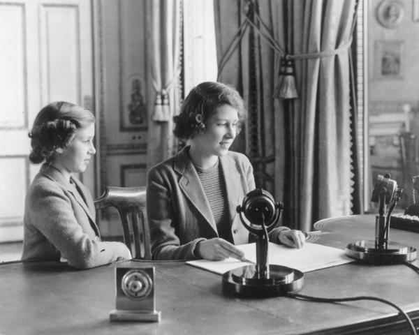 Princess Margaret watches her older sister Princess Elizabeth make her first broadcast on Oct. 12, 1940 in London.