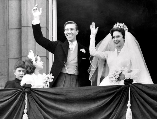 Princess Margaret and Antony Armstrong-Jones wave from Buckingham Palace on their wedding day in May 1960.