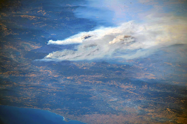 Smoke billows from the Mendocino Fire Complex north of Clear Lake, Calif. on Aug. 2, 2018.