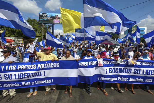 Demonstrators march to demand freedom for political prisoners in Managua on Aug. 11. The ongoing unrest in Nicaragua began in April, when President Daniel Ortega announced cuts to the social security system and small protests by senior citizens were violently broken up.