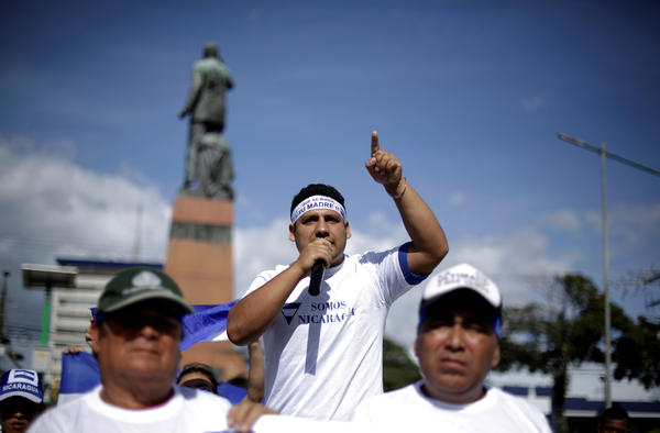 Nicaraguan refugees fleeing their country due to unrest take part in a demonstration to thank the people of Costa Rica for their support in San José, Costa Rica, on Wednesday.