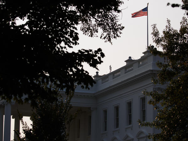 An American flag above the White House flew at full-staff early on Monday after the death of Sen. John McCain, R-Ariz. Later the White House issued a proclamation lowering flags to half-staff.