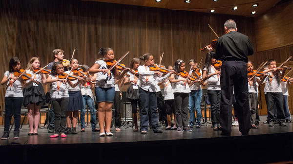 Nathan Schram (back row, third from left) performs with his students from PS 75 in Brooklyn.