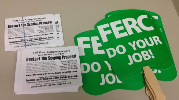 Opponents carried these signs at a FERC public hearing on the project.