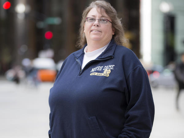 A federal appeals court ruled Tuesday that the 1964 Civil Rights Act protects LGBT employees from workplace discrimination, setting up a likely battle before the Supreme Court and gay rights advocates. Indiana teacher Kimberly Hively, shown here in 2015, filed a lawsuit alleging that Ivy Tech Community College in South Bend didn't hire her full time because she is a lesbian.